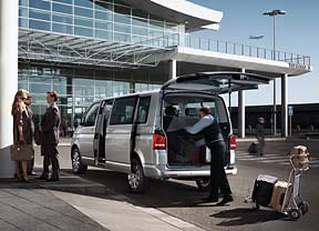 Airport shuttle driver loading luggage